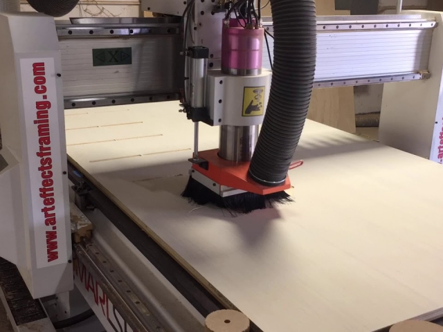showing how the CNC machine cuts pieces for curved mantels